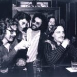 Taken in the front bar...Tom Rush, Michael Ochs, Allan Rinde, Elliot Roberts and James Taylor / Circa 1972 / Photo courtesy of Pam McKenna