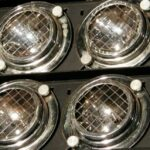 Series of silver lights with mesh covers.